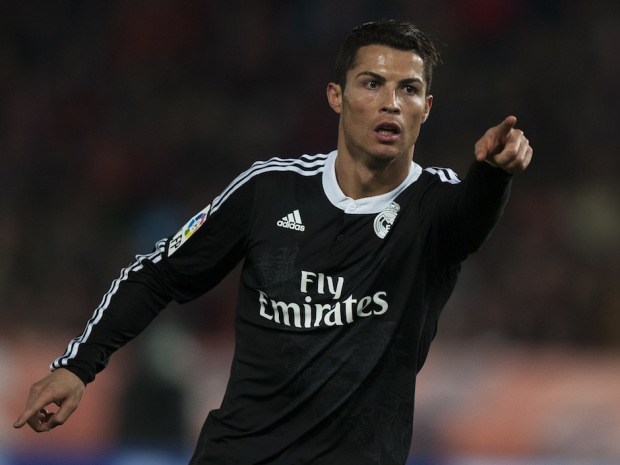 Real Madrid's Cristiano Ronaldo from Portugal, celebrates his second goal against UD Almeria's, during a Spanish La Liga soccer match at the Juegos Mediterraneos stadium in Almeria, southeast Spain, Friday, Dec. 12, 2014. (AP Photo/Daniel Tejedor)