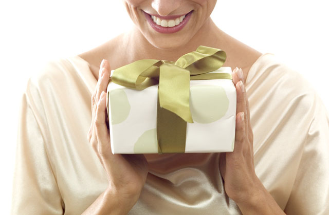 Woman Receiving a Gift --- Image by © Royalty-Free/Corbis