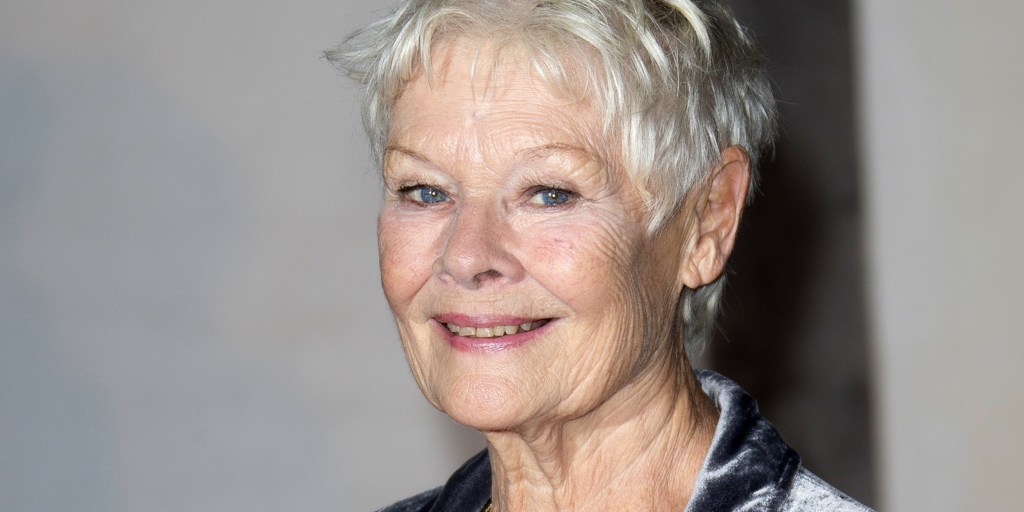 "FILE - This Oct. 17, 2013 file photo shows British actress Judi Dench at the Globe Theatre in central London, for a Gala evening. Dench was nominated for a Golden Globe for best actress in a motion picture drama for her role in the film ""Philomena"" on Thursday, Dec. 12, 2013. The 71st annual Golden Globes will air on Sunday, Jan. 12. (Photo by Joel Ryan/Invision/AP, File)"