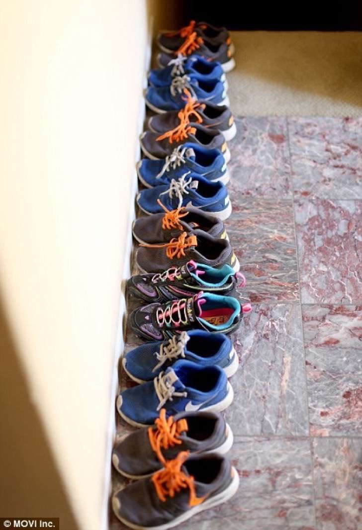 38166BBB00000578-3781725-Eight_pairs_of_trainers_are_lined_up_neatly_in_the_house-a-7_1473705258112-2