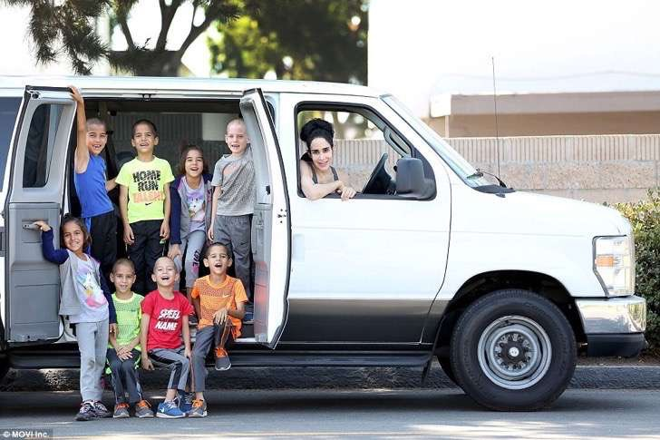3816743A00000578-3781725-Just_enough_room_The_kids_need_a_van_to_ferry_them_all_around_Th-a-5_1473705243532-2